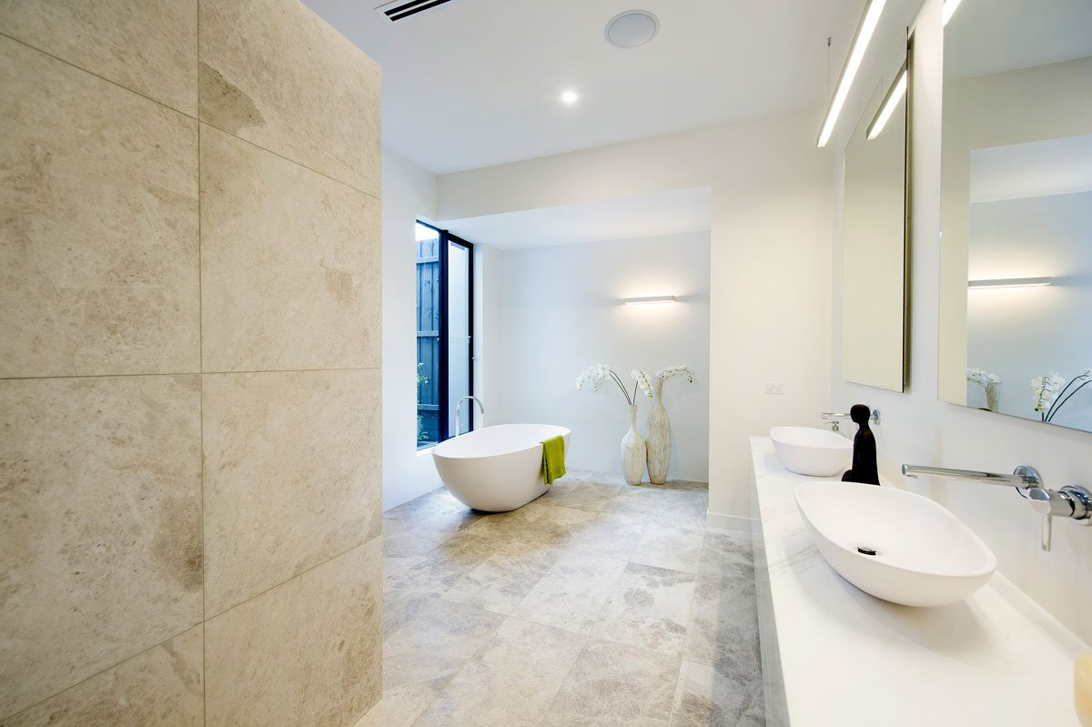 Bathroom with grey tundra stone tiles and free standing bath