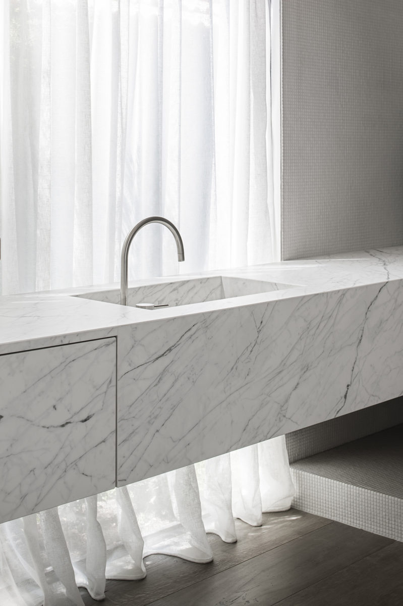 Floating bathroom vanity made using marble look porcelain slabs by Laminam