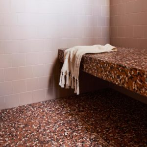 Shower seat made using red Terrazzo tiles from Signorino