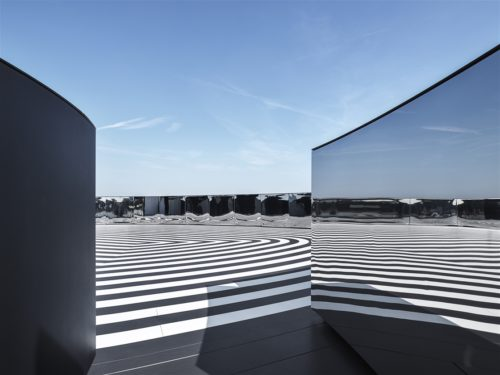 Black and white tiles make a hypnotic pattern on the rooftop of Fondazione Prada